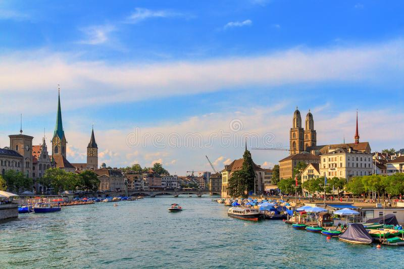 Zurich skyline churches. Beautiful summer cityscape of Zurich, Switzerland, at the river Limmat with the Fraumünster, Grossmünster and St. Peter Churches royalty free stock photography