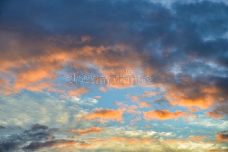 Beautiful summer cloudscape with vibrant colors. Filling the sky stock image
