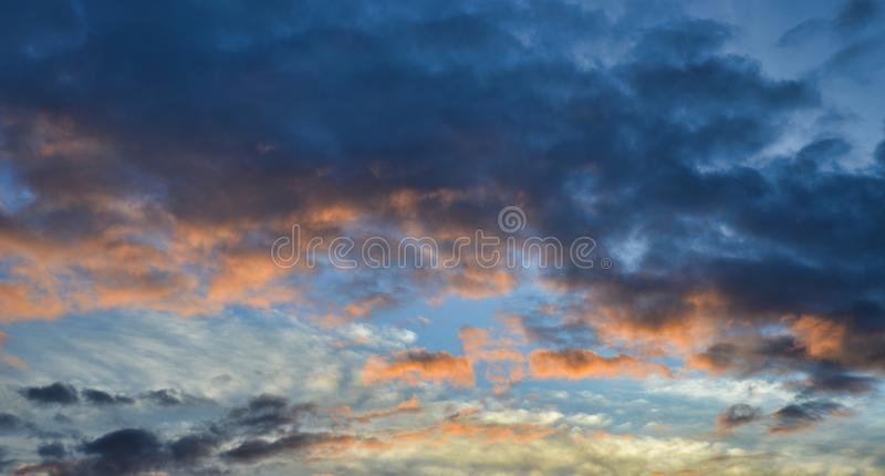 Beautiful summer cloudscape with vibrant colors. Filling the sky stock photo