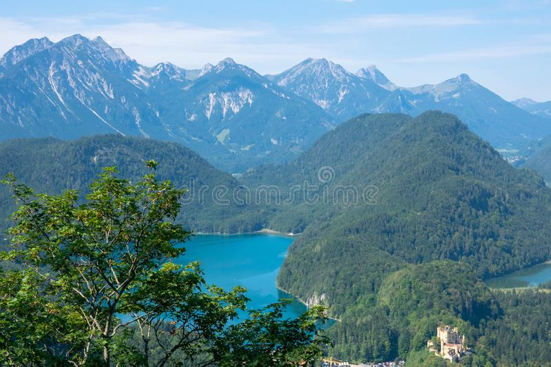 Beautiful summer day in bavarian Alps with a view to Alpsee lake and Neuschwanstein castle Germany from hiking trail royalty free stock images