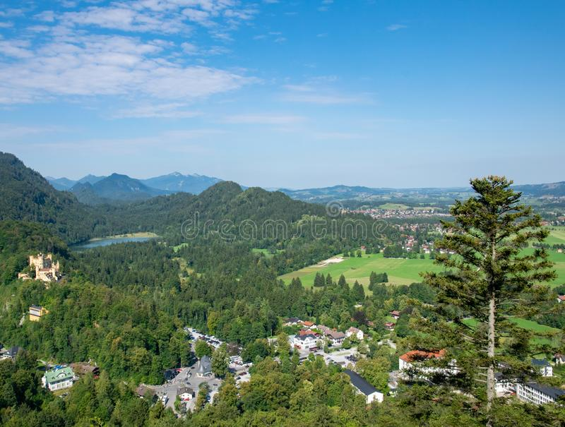 Beautiful summer day in bavarian Alps with a view to Alpsee lake and Neuschwanstein castle Germany from hiking trail royalty free stock photography