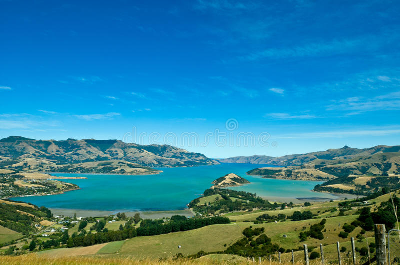 Beautiful summer day view into the Akaroa Harbour. New Zealand stock images