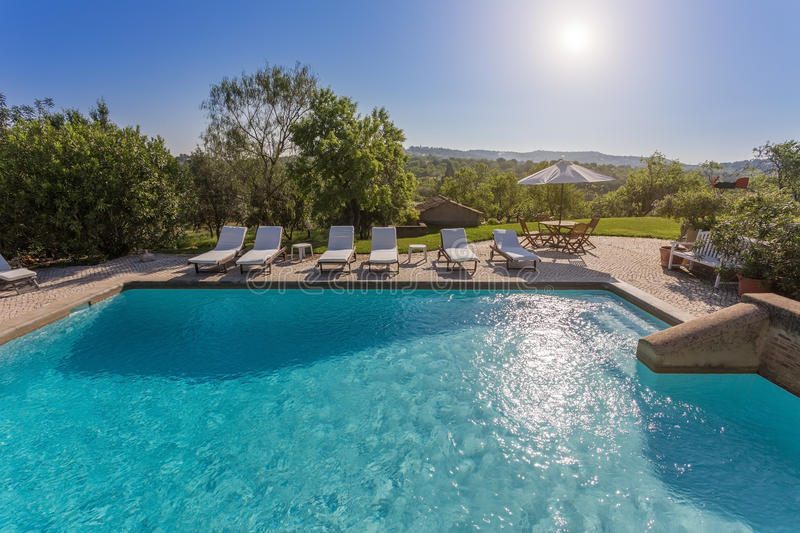 Beautiful summer garden with a swimming pool. stock photos