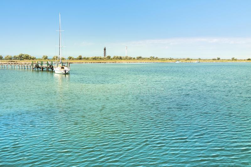 Beautiful summer landscape in the Black sea near the Dzharylhach island, marina, yacht and two lighthouses in the background. Beautiful summer landscape in the stock images