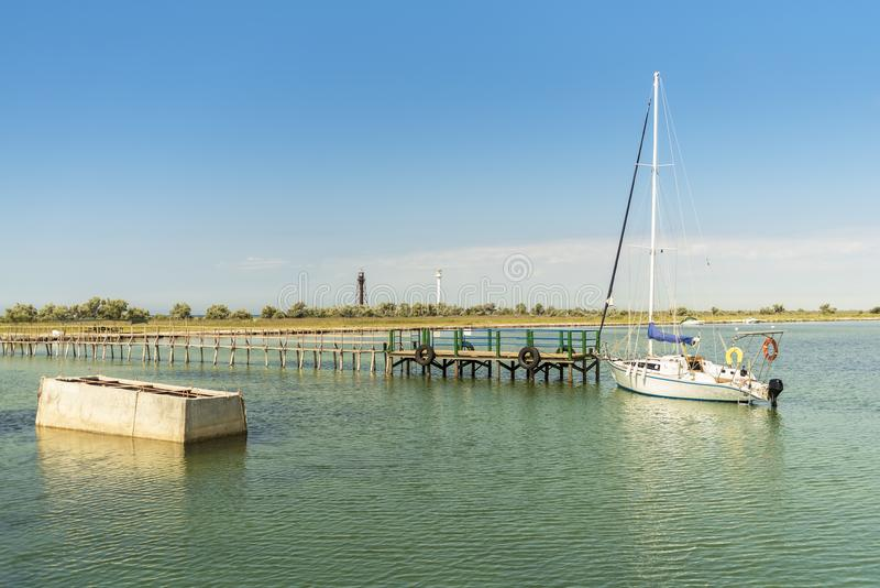 Beautiful summer landscape in the Black sea near the Dzharylhach island, marina, yacht and two lighthouses in the background. Beautiful summer landscape in the stock photo