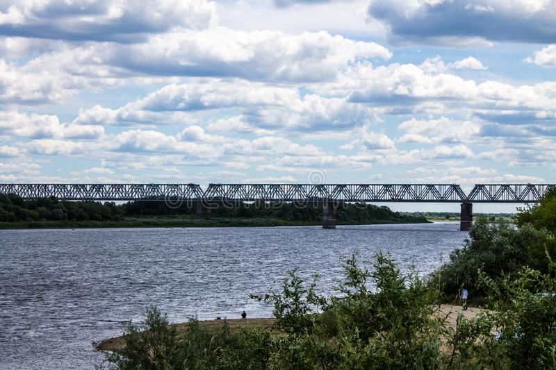 Summer landscape on the Oka river in Murom, Russia with a railway bridge royalty free stock image