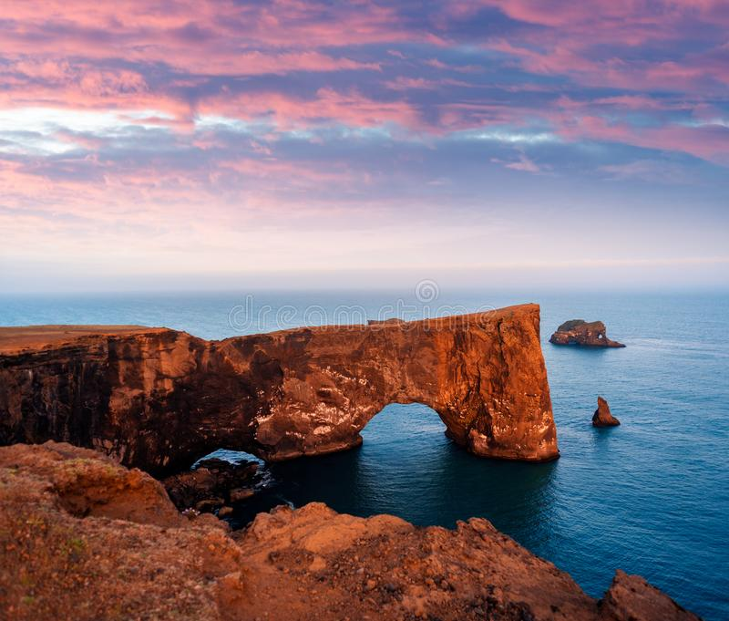 Cape Dyrholaey in Iceland. Beautiful summer landscape with rocky cape and ocean. Southern coast of Iceland. View of peninsula Dyrholaey, not far from the village royalty free stock photography