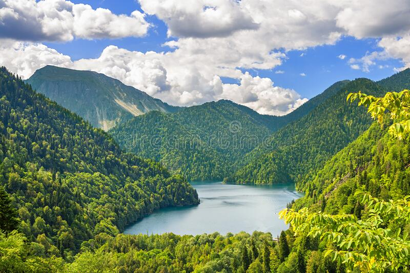 Summer mountain landscape with highland lake. Beautiful summer mountain landscape with highland lake. top view of forest high mountain lake stock images