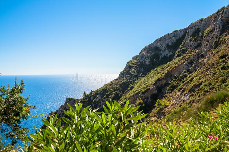 Beautiful summer panoramic seascape. View of the coastline into the sea bays with crystal clear azure water. In the stock images