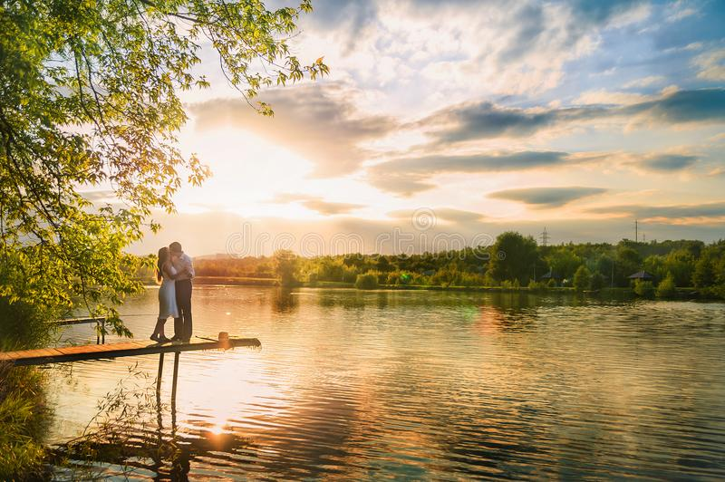 Beautiful summer picture on the nature by the river. A loving couple stock images
