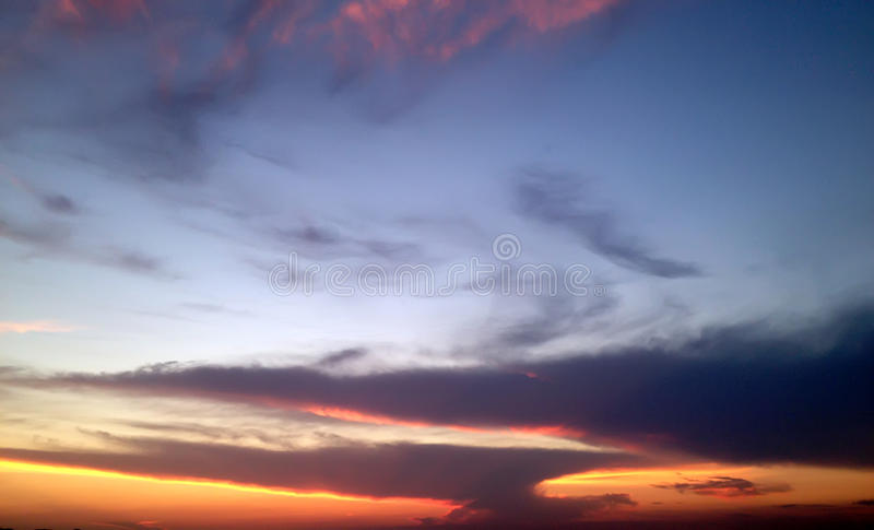 Beautiful summer purple sunset on the background of clouds stock photography