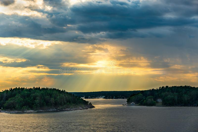 Beautiful summer Scandinavian midnight sun. Dramatic cloud sunset over islands and sea in the Swedish archipelago. stock image