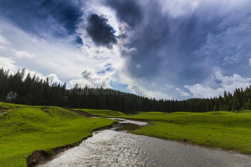 Beautiful summer scenery in remote rural area in the mountains in Europe, with storm clouds stock images