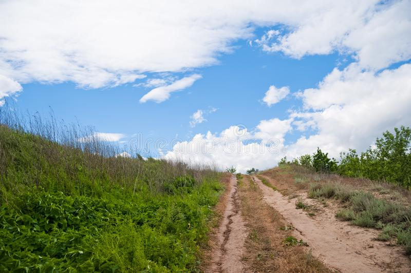 Beautiful summer spring nature of the Saratov region. Cloudy day, the path to the house royalty free stock photos