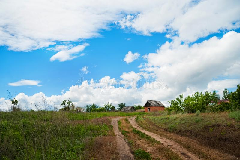 Beautiful summer spring nature of the Saratov region. Cloudy day, the path to the house royalty free stock image