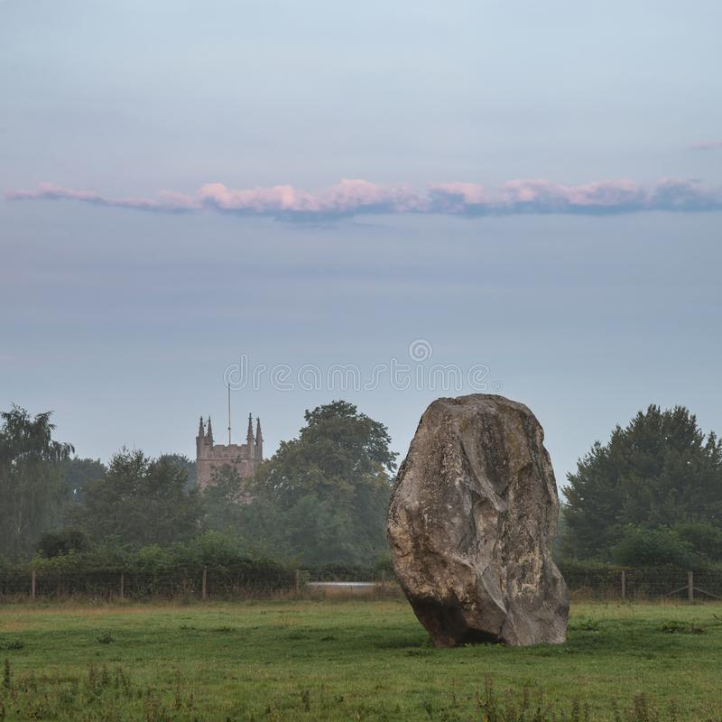 Stunning Summer sunrise landscape of Neolithic standing stones in English cluntryside with gorgeous light with slight background stock images