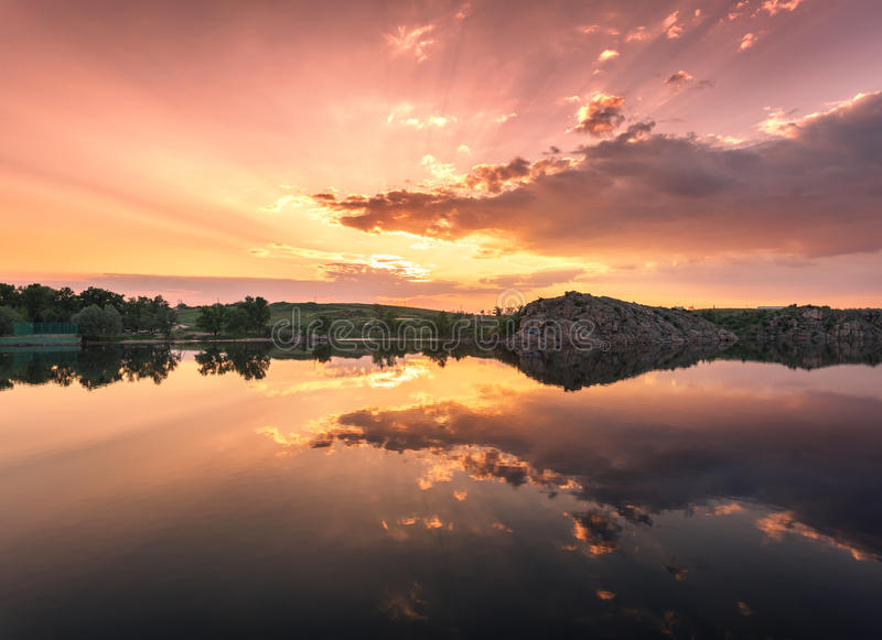 Beautiful summer sunset at the river with colorful sky royalty free stock photography