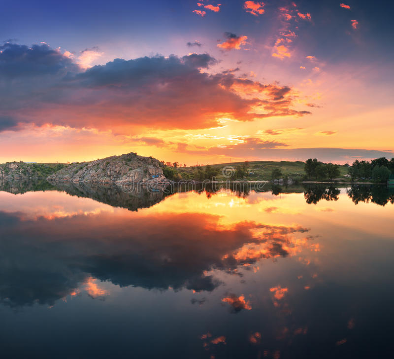 Beautiful summer sunset at the river with colorful sky royalty free stock photo
