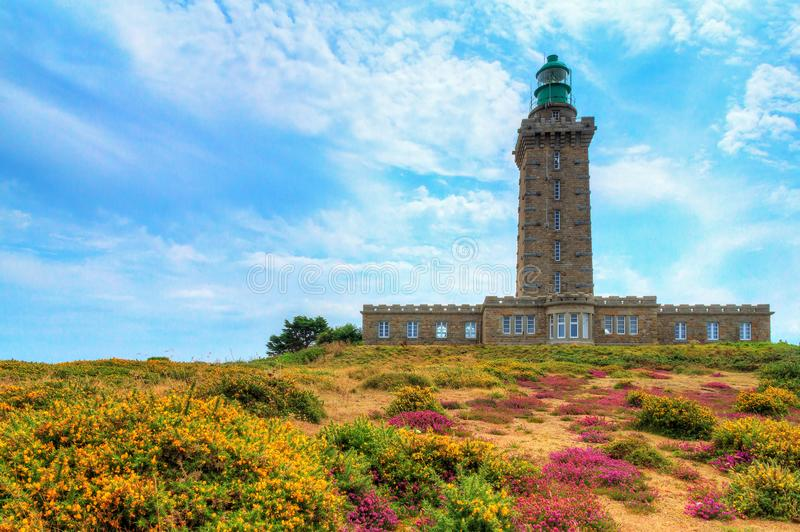 Phare du Cap Frehel in summer. Beautiful summer view of the lighthouses at Cap Fréhel in Brittany, France, with vibrant heather flowers Calluna vulgaris and stock photography