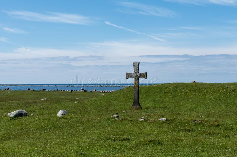 Beautiful summer view with a stone cross from the south end of. Beautiful summer view of the south end of öland with an old stone cross on a field near the royalty free stock photography