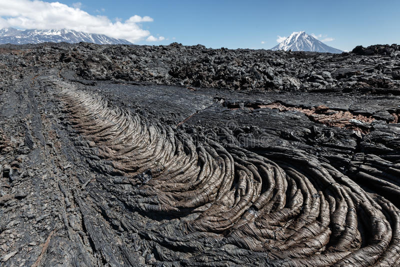 Beautiful summer volcanic landscape of Kamchatka Peninsula. Volcanic landscape of Kamchatka Peninsula: beautiful view of lava field volcanic eruption active stock photography