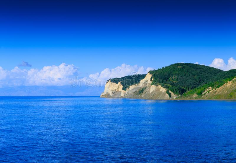 Beautiful summertime panoramic seascape. View of the crystal clear azure sea bay and limestone cliffs. Agios Stefanos cape. Ag. S royalty free stock photography