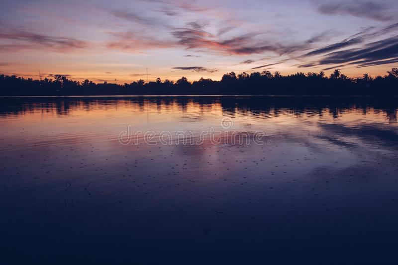 Beautiful sun light in the evening at the river. Nature, sunset, sky, landscape, sunrise, water, cloud, outdoor, summer, morning, blue, background, dawn stock images