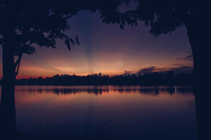 Beautiful sun light in the evening at the river. Nature, sunset, sky, landscape, sunrise, water, cloud, outdoor, summer, morning, blue, background, dawn royalty free stock photography