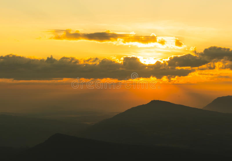 Beautiful sun ray. Stab from cloud and mountain royalty free stock image