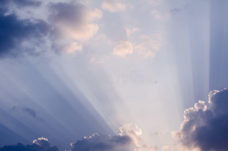 Beautiful sun rays on a summer blue sky royalty free stock photo