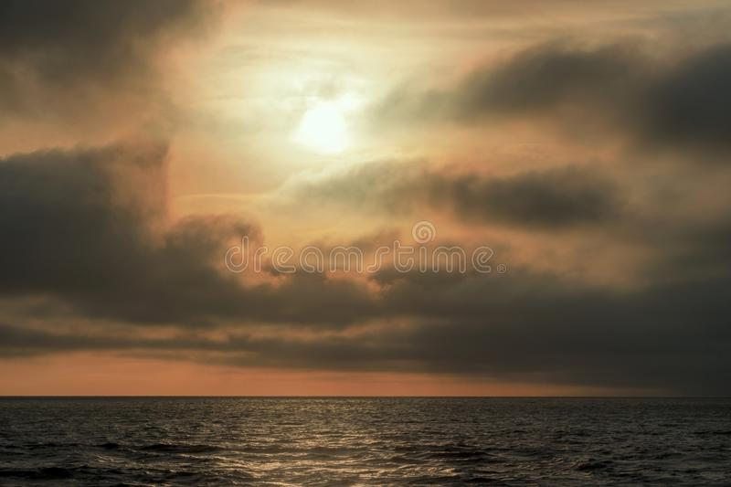 Beautiful sun rays of sunset with dramatic  of sky background. Beautiful sun rays of sunset with dramatic colorful of sky background royalty free stock photos