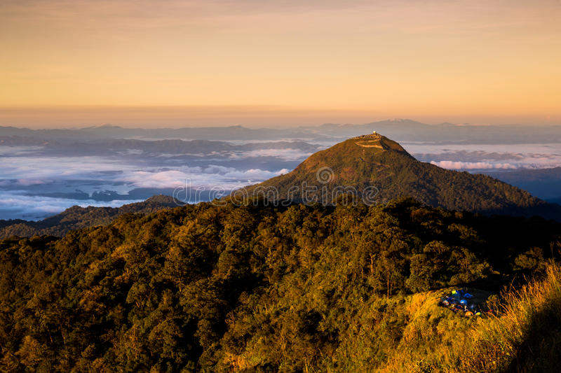 Beautiful sun rise on top mountain with could and camping area royalty free stock photography