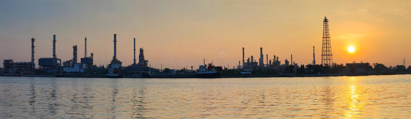 Beautiful sun rising scene with oil ,gas refinery industry estate and marine tanker logistic port stock photos