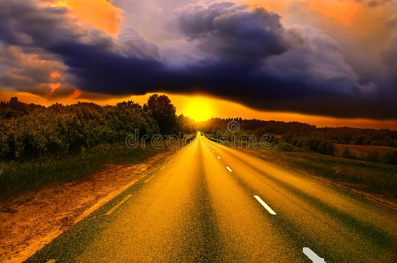 Beautiful sunny road in the morning. Beautiful sun rising sky with asphalt highways road and storm clouds, Driving on an empty road at lovely sunny day. Sun royalty free stock images