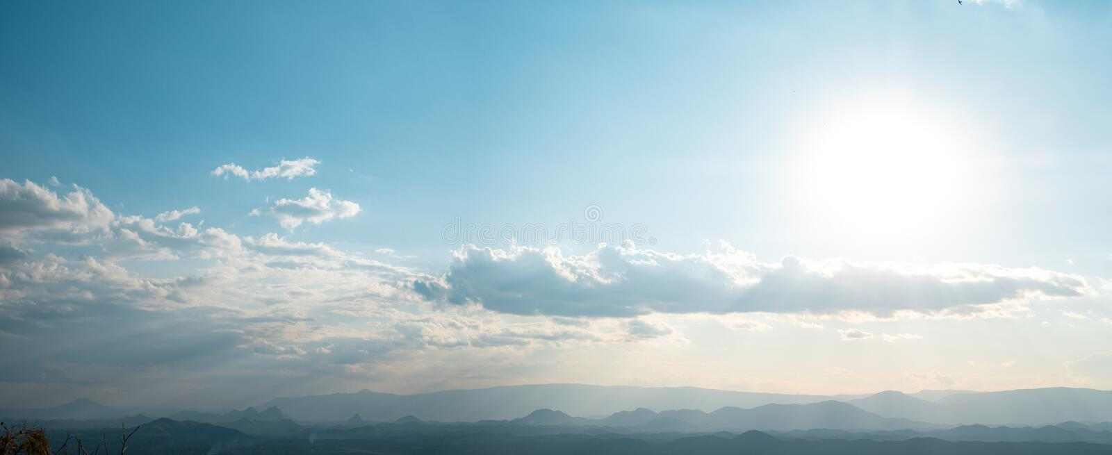Beautiful sun sky cloud at the mountain range and the city in the background. Photo Loei  city Thailand from Phu Bo Bit mountain peak stock image