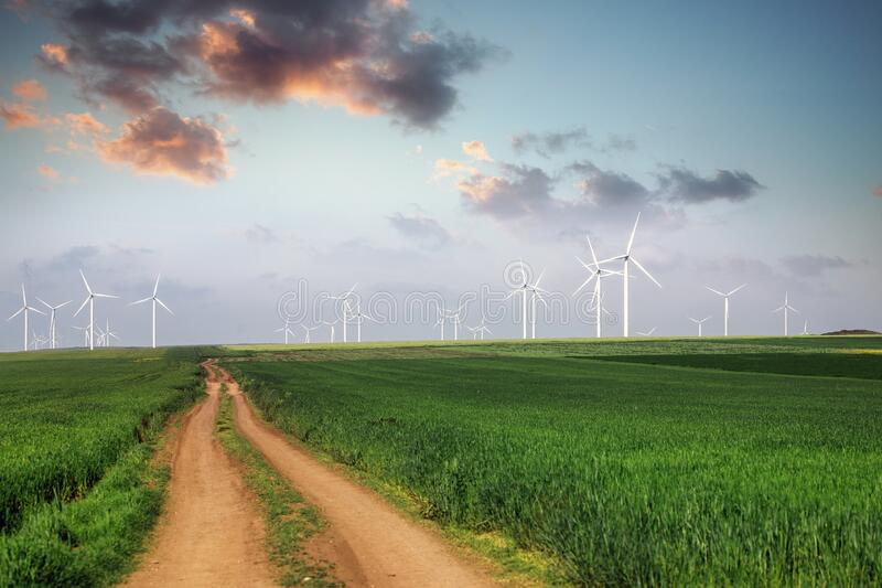 Windmills on the field with Beautiful sundown clouds above Landscape with hills and wind turbines stock photography