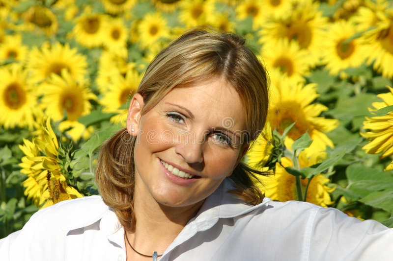 Beautiful Sunflower Woman. In the sun stock photography