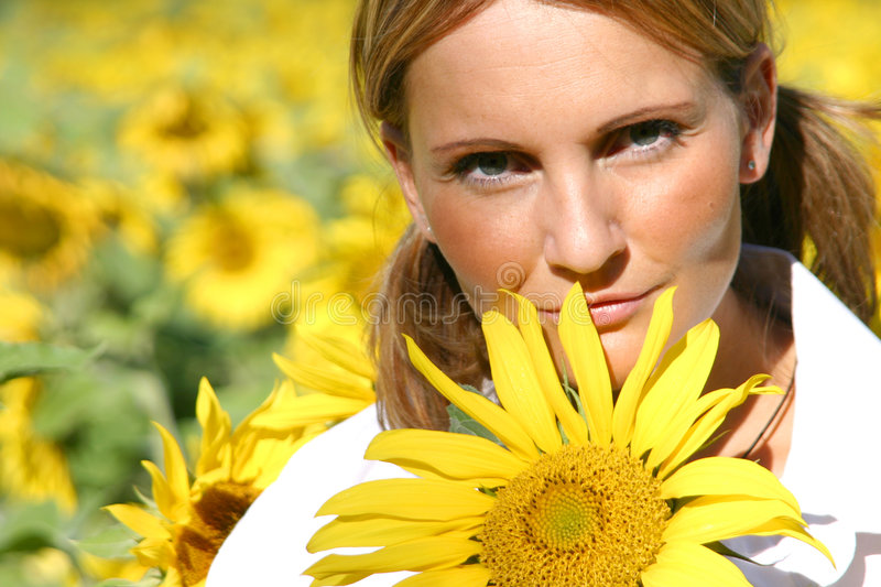 Beautiful Sunflower Woman. In the sun royalty free stock image