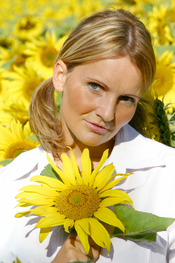 Beautiful Sunflower Woman. In the sun royalty free stock photography