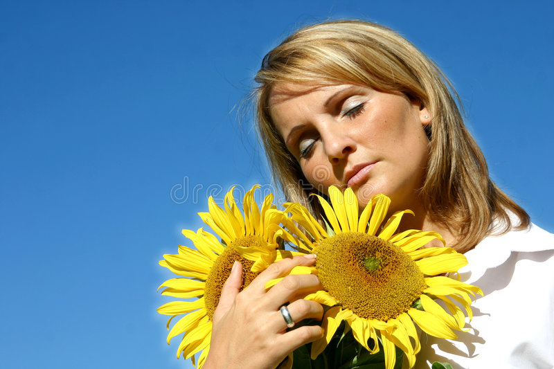 Beautiful Sunflower Woman. And a blue sky royalty free stock image