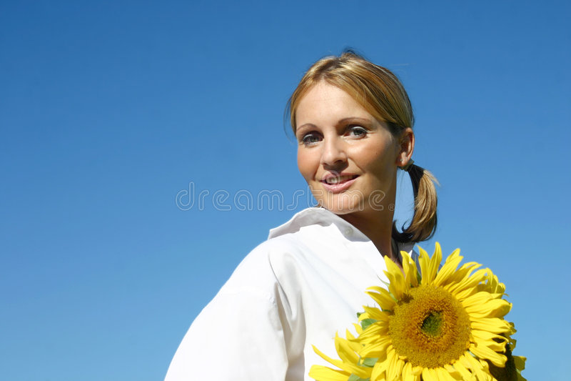 Beautiful Sunflower Woman. And a blue sky royalty free stock photography