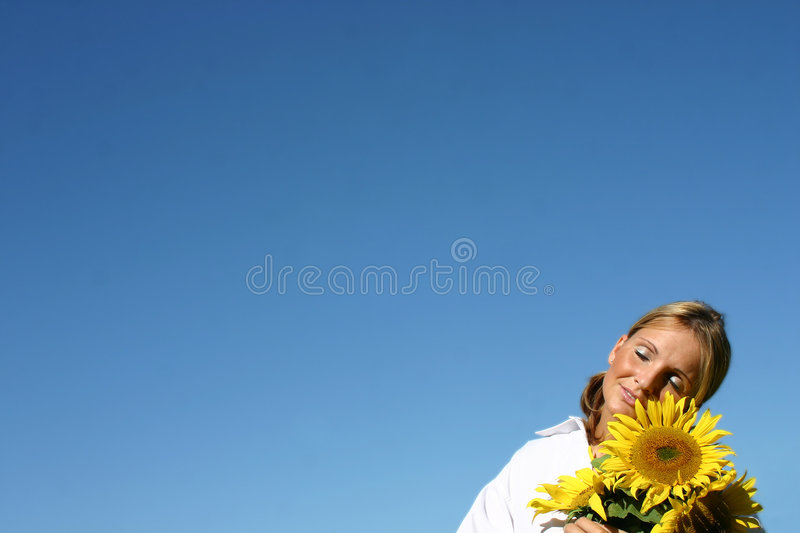 Beautiful Sunflower Woman. And a blue sky royalty free stock images