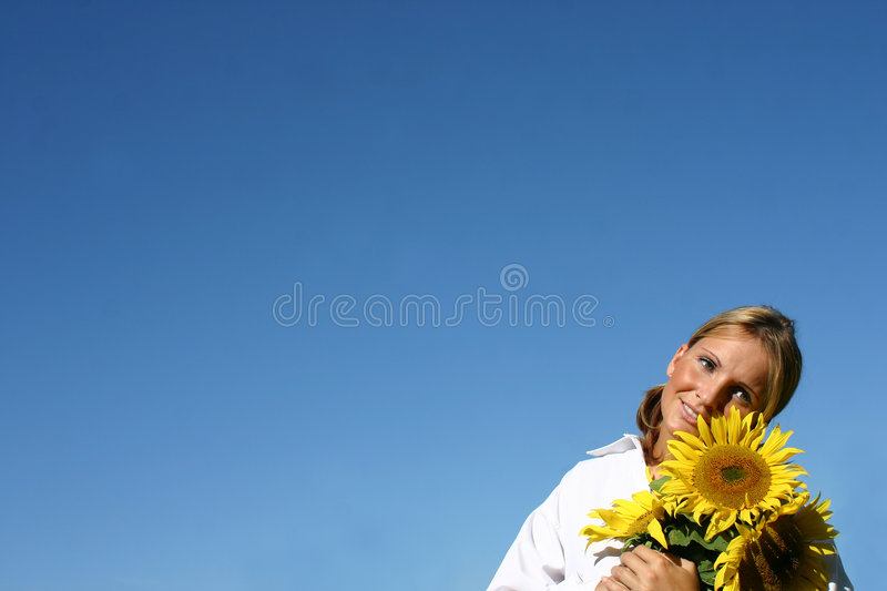 Beautiful Sunflower Woman. And a blue sky stock photo