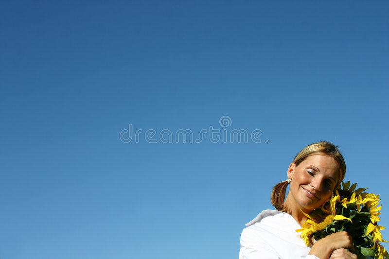 Beautiful Sunflower Woman. And a blue sky stock photography