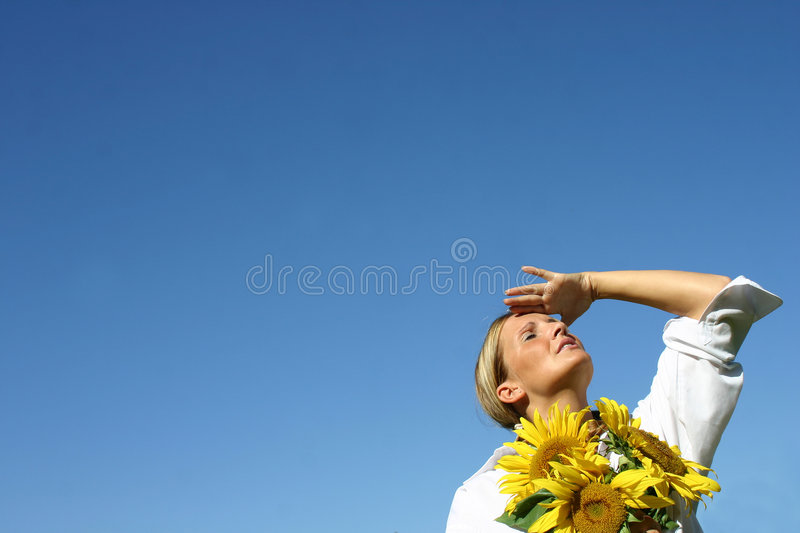 Beautiful Sunflower Woman. And a blue sky stock images