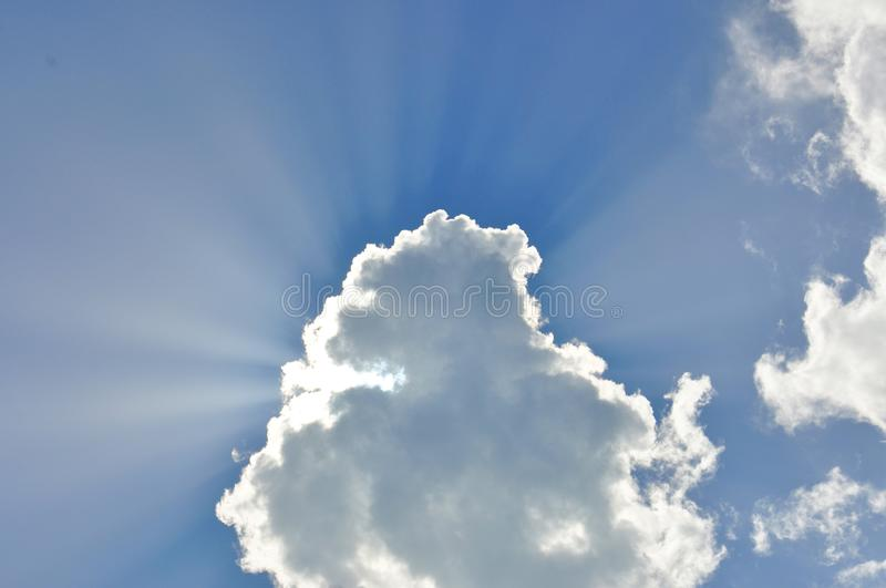 Beautiful sunligh trought the clouds. On the sky royalty free stock photo