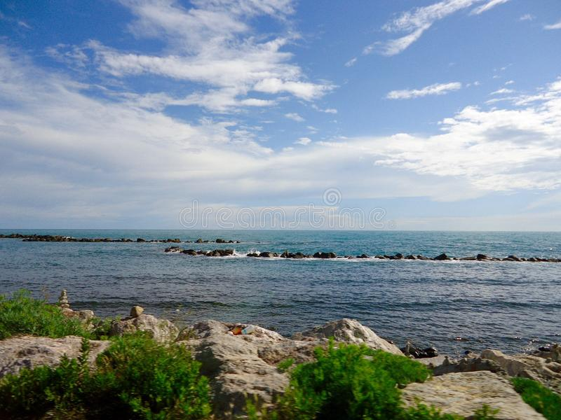 A beautiful sunny day at the beach. This is a noce view of the beach at Marina di Carrara in Italy. The sun was shining. The sea was blue stock photography