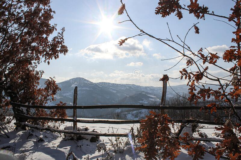A beautiful sunny day mixed with snow on the mountain. stock images
