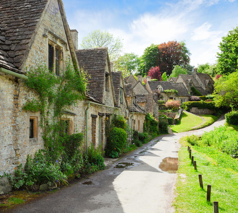 A beautiful sunny morning in Bibury, Gloucestershir, England, UK. Old street with traditional cottages.  stock photography