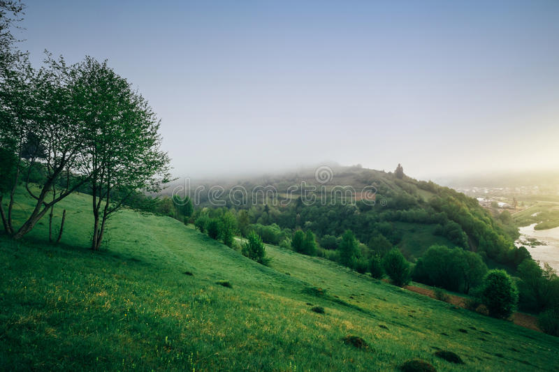 Beautiful sunny morning in mountain landscape, mountain valley, river in morning fog at sunrise. Location - Carpathian royalty free stock photos